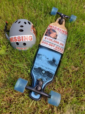 Keep spreading the word that Madison Scott is missing. Picture of skate board and helmet with Madison Scott missing stickers.